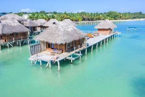 Tourist relaxing on a overwater bungalow. Bocas Del Toro, Panama