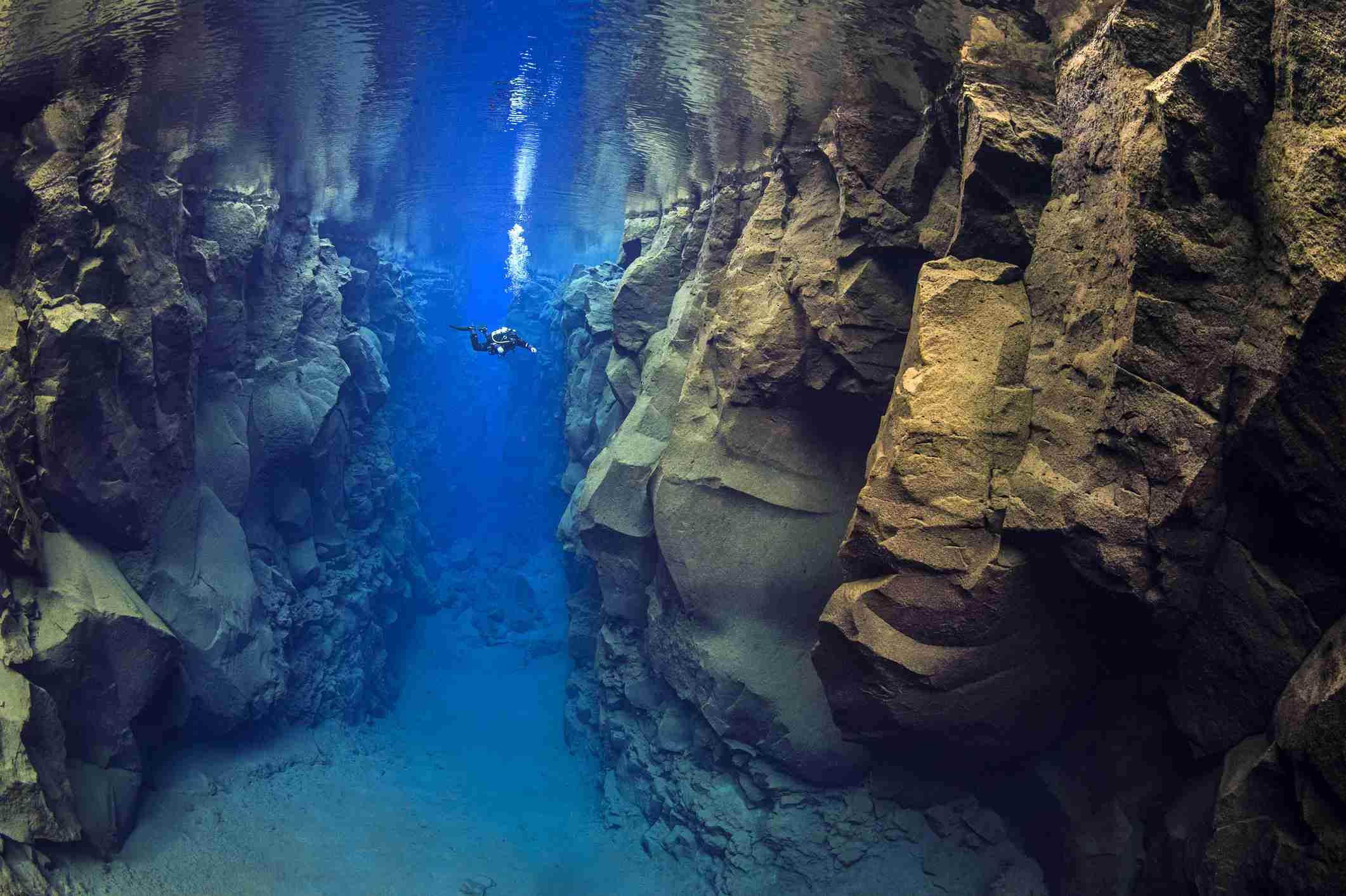 A diver explores Silfra Canyon
