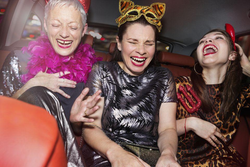 Ladies laughing in halloween costumes