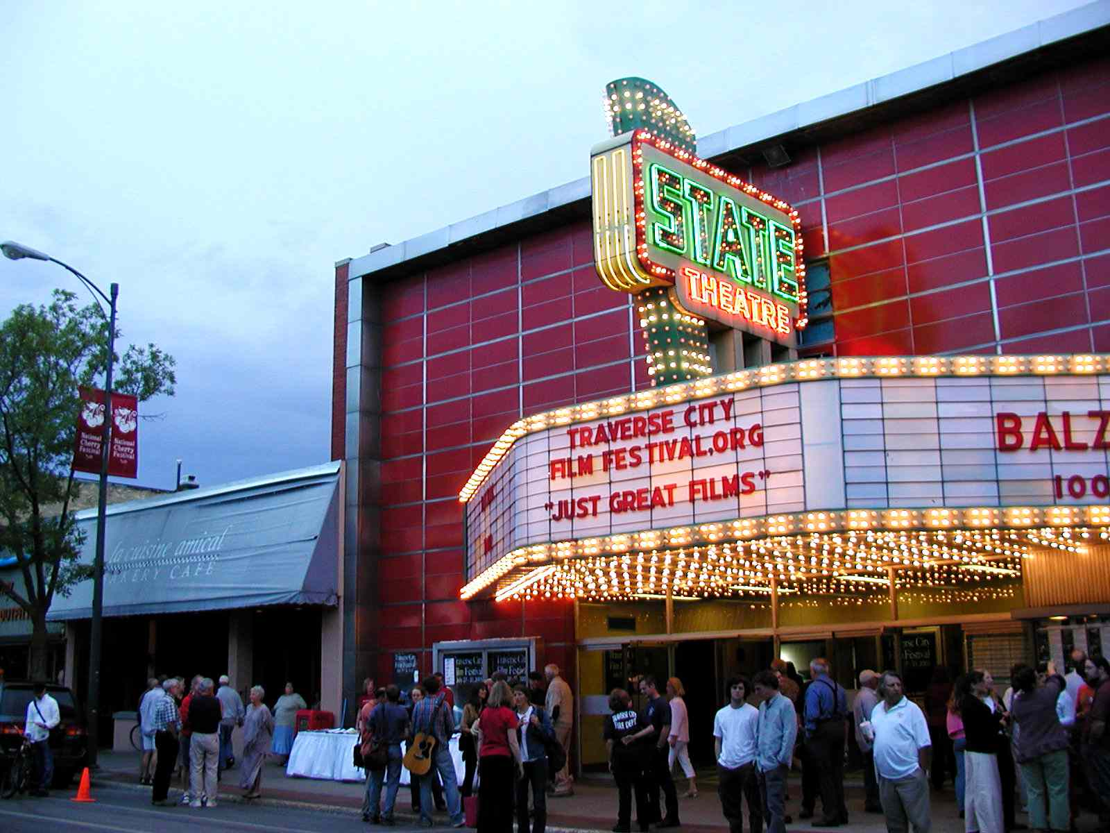 State Theatre in Traverse City Michigan at twilight with people waiting outside