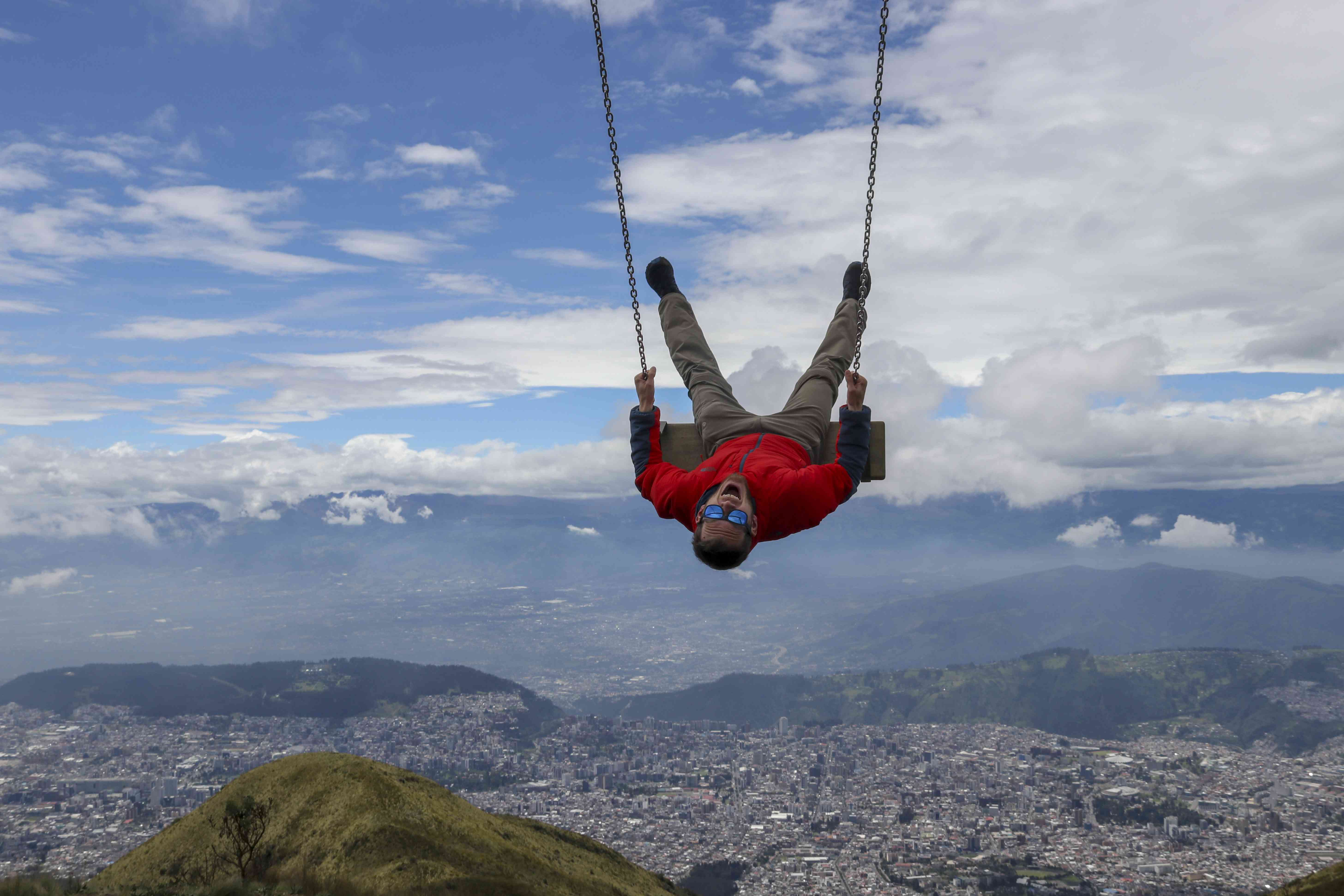 View of Quito from a swing on Pichincha Volcano