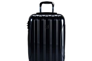 DELSEY black luggage on white background