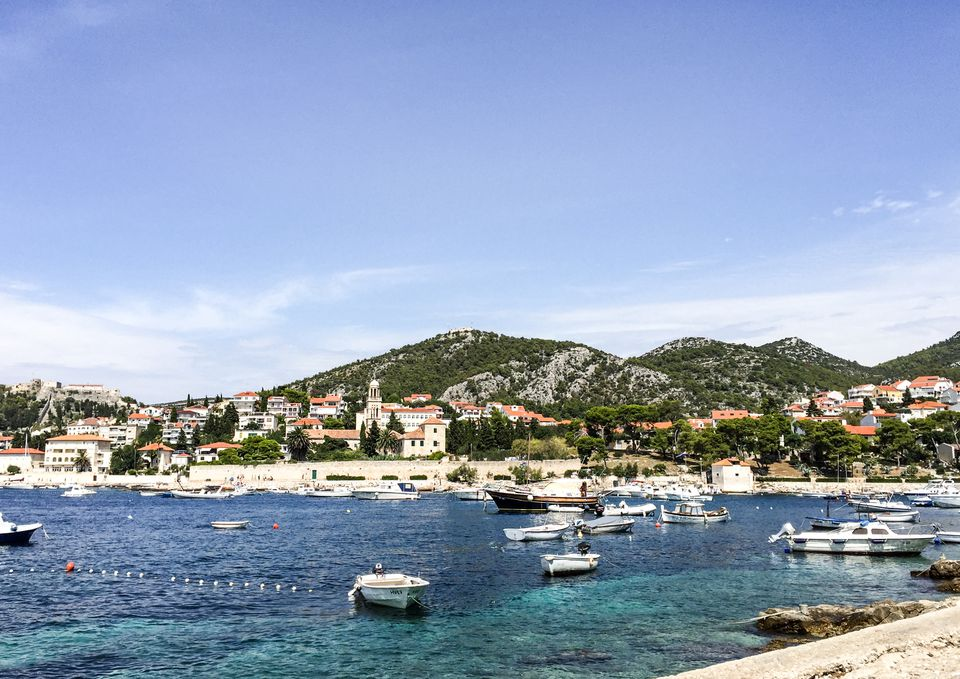 Boats docked along the coastline of Hvar