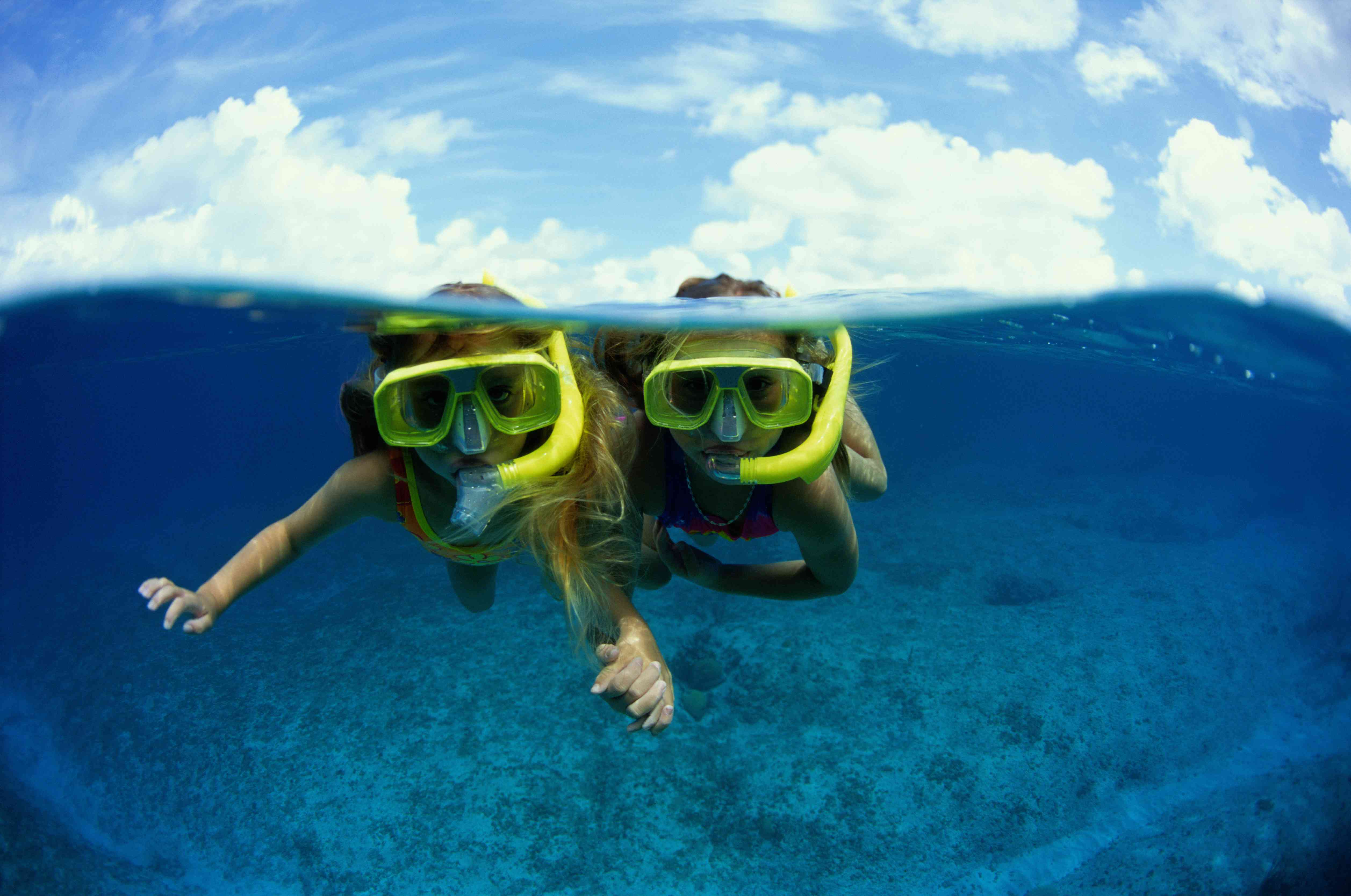 Two young girls snorkeling
