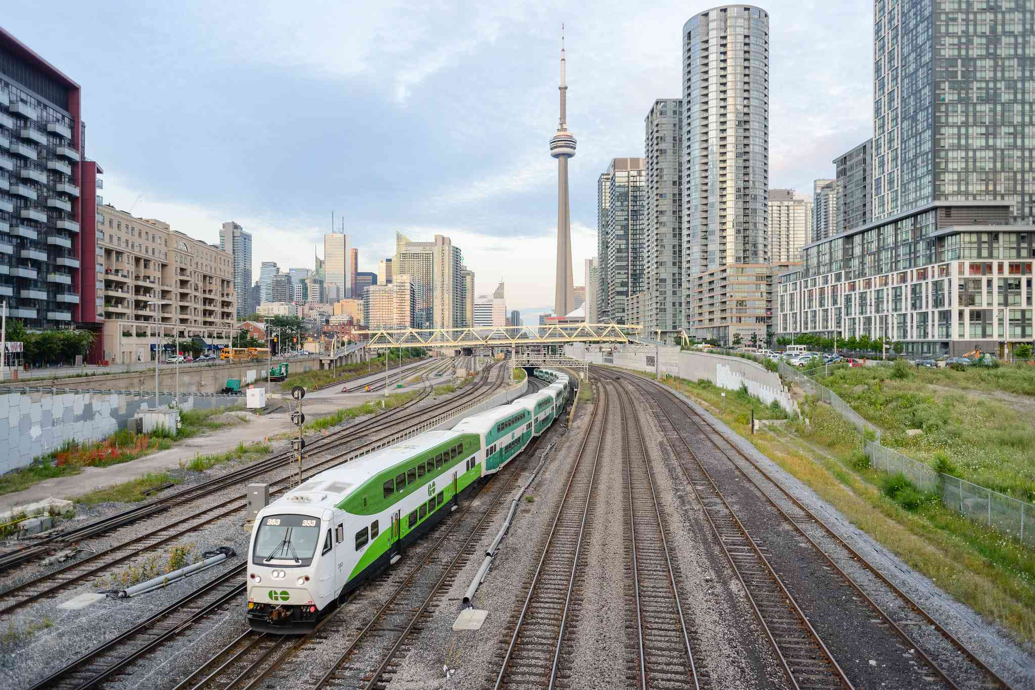 A GO Transit train leaving Toronto, in the background is the CN Tower