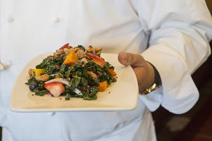Chef holding a plate of salad