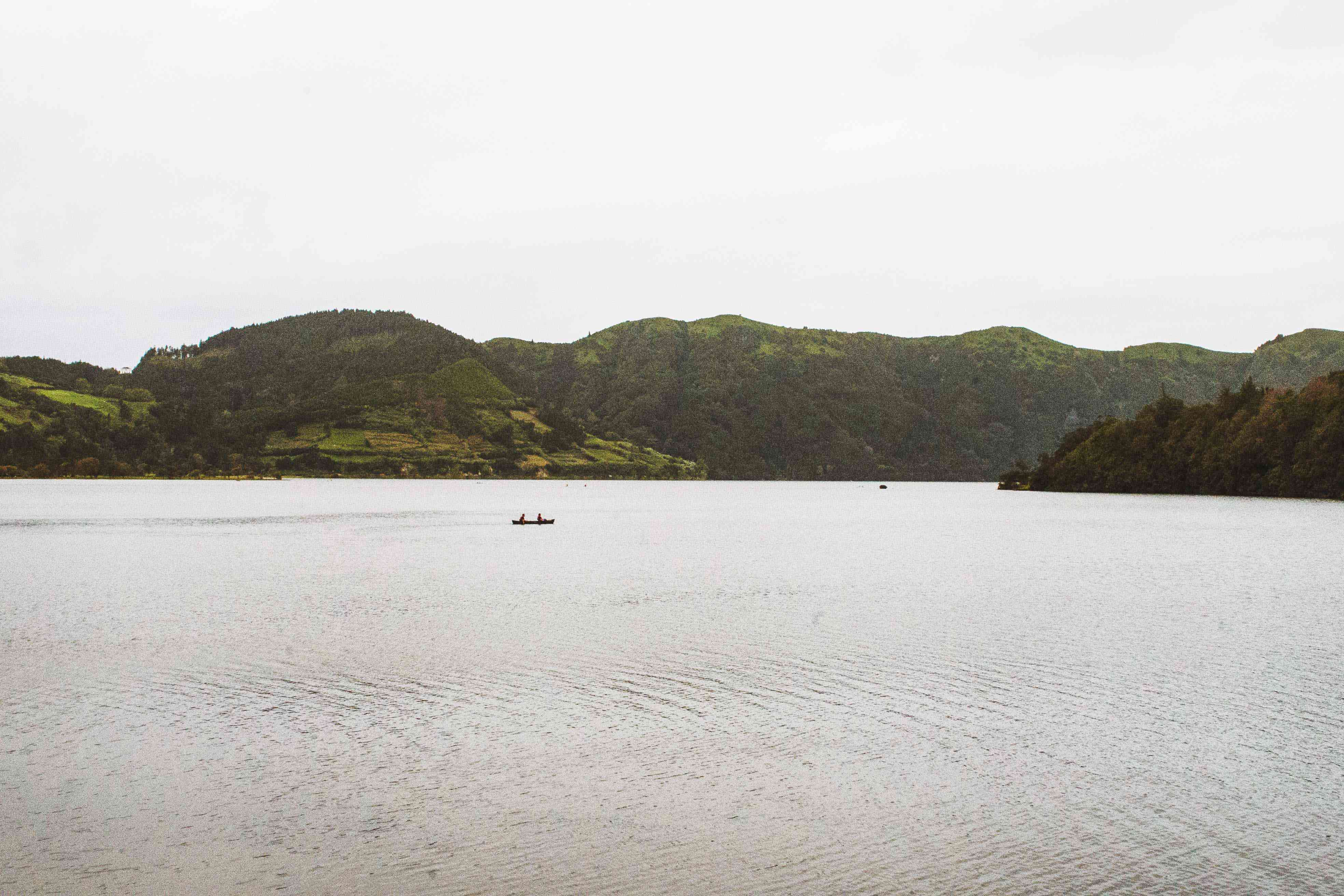 People canoeing on a lake in the azores