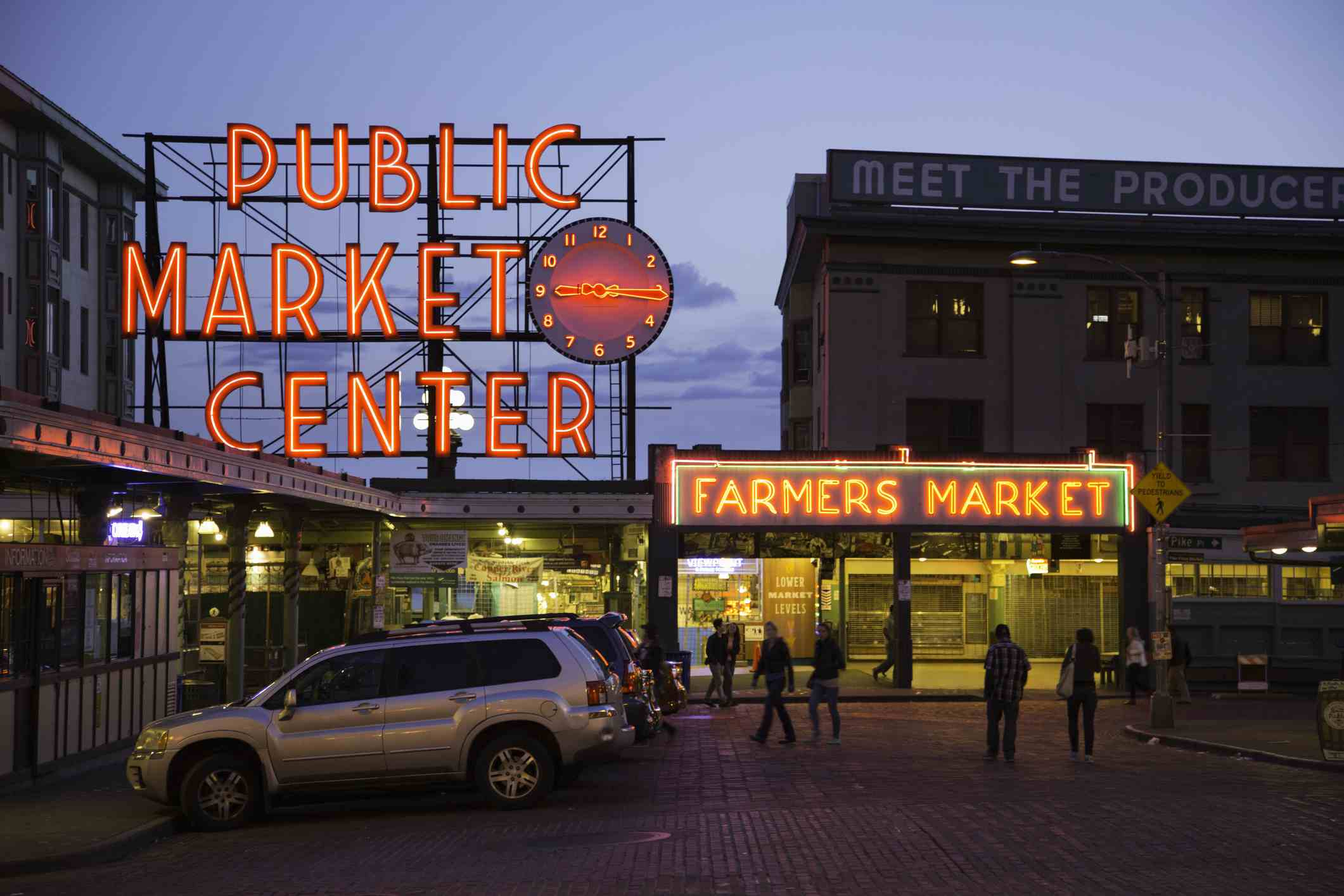 Pike Place market neon signs at dusk.