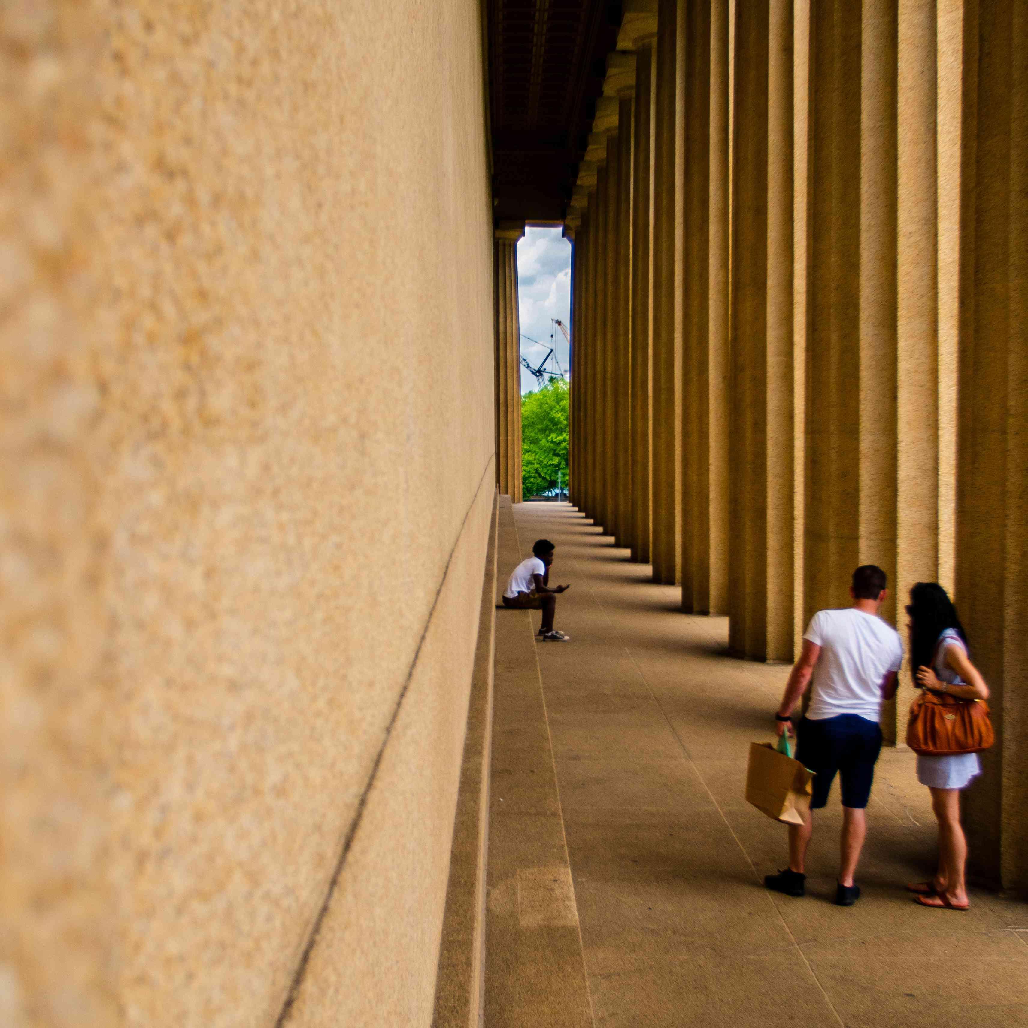 People walking along the Parthenon