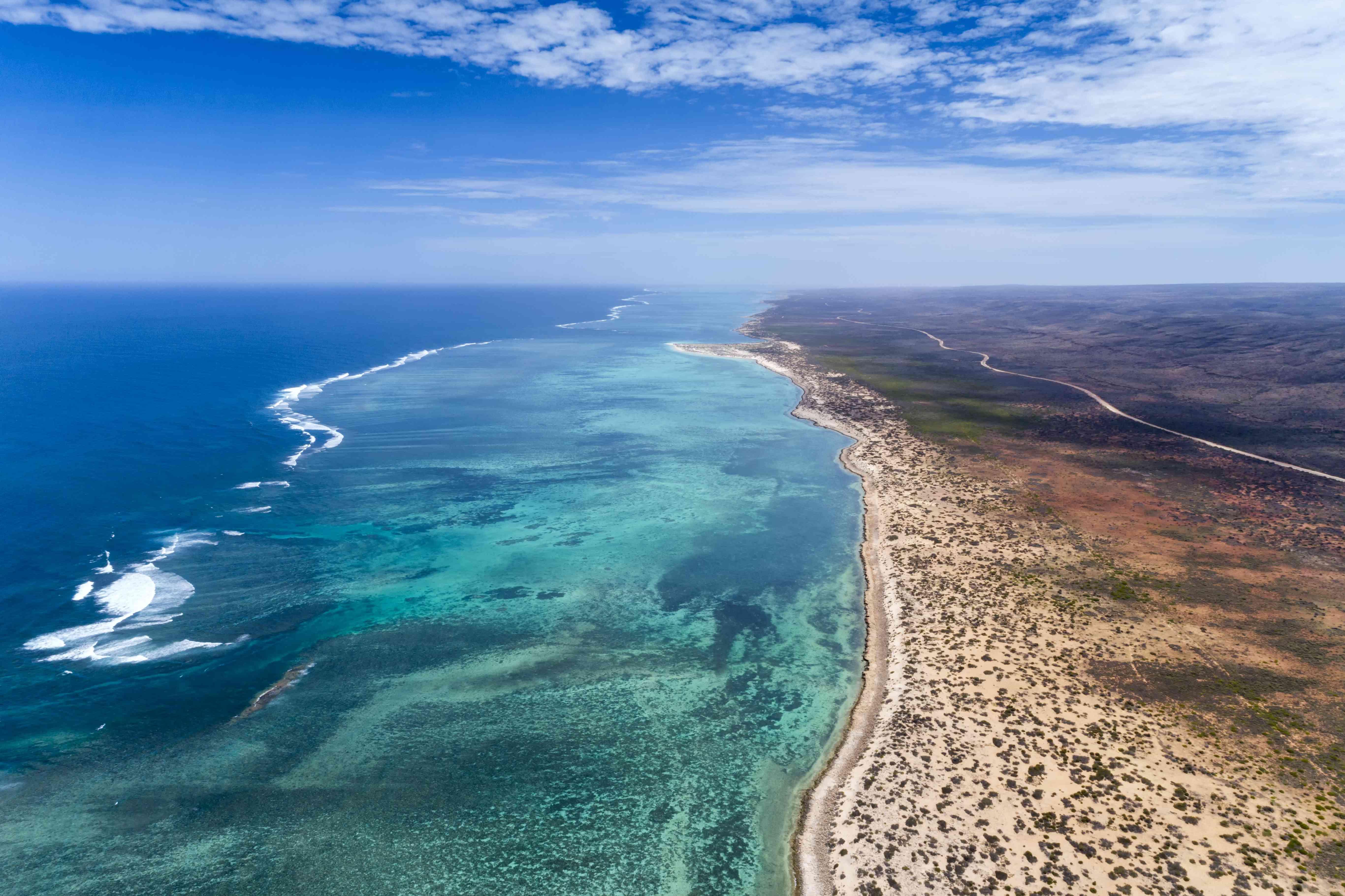 Aerial over the turquoise sea on the coast near Exmouth, Australia