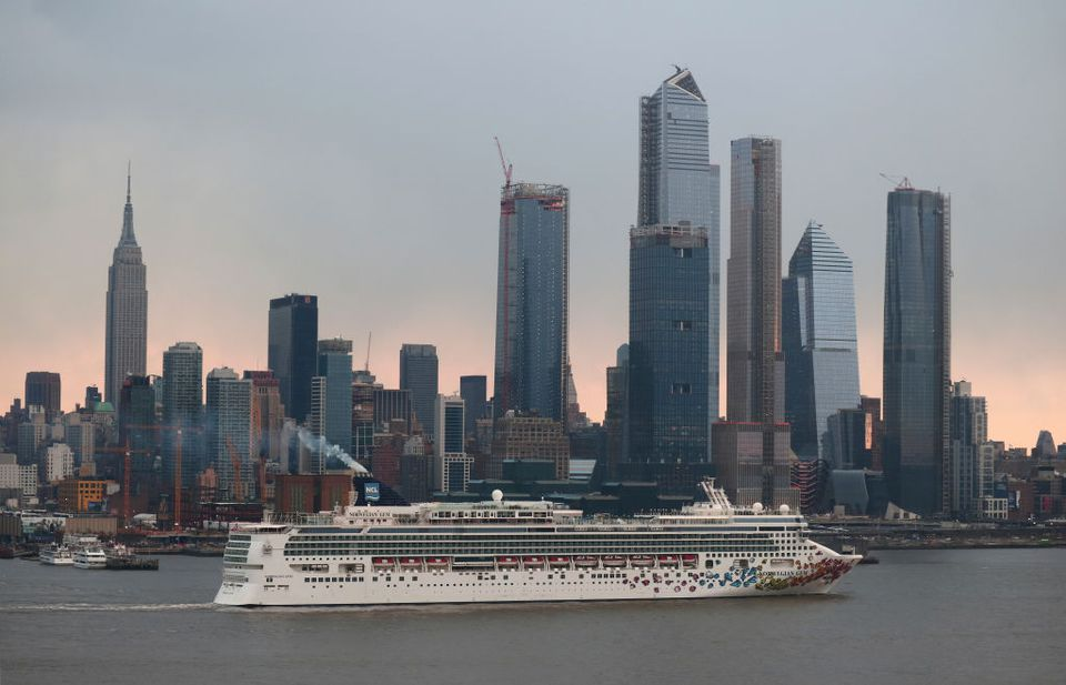 The Norwegian Gem cruise ship sails in the Hudson River in front of the Empire State Building
