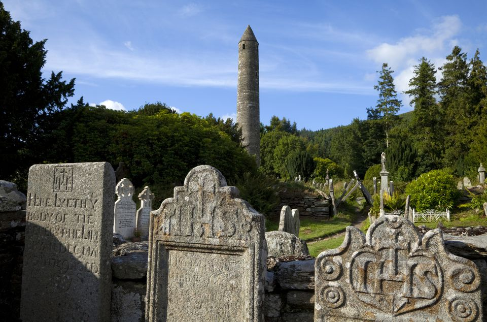 Round Tower and Graveyard in Glendalough Early Monastic Site, County Wicklow, Ireland