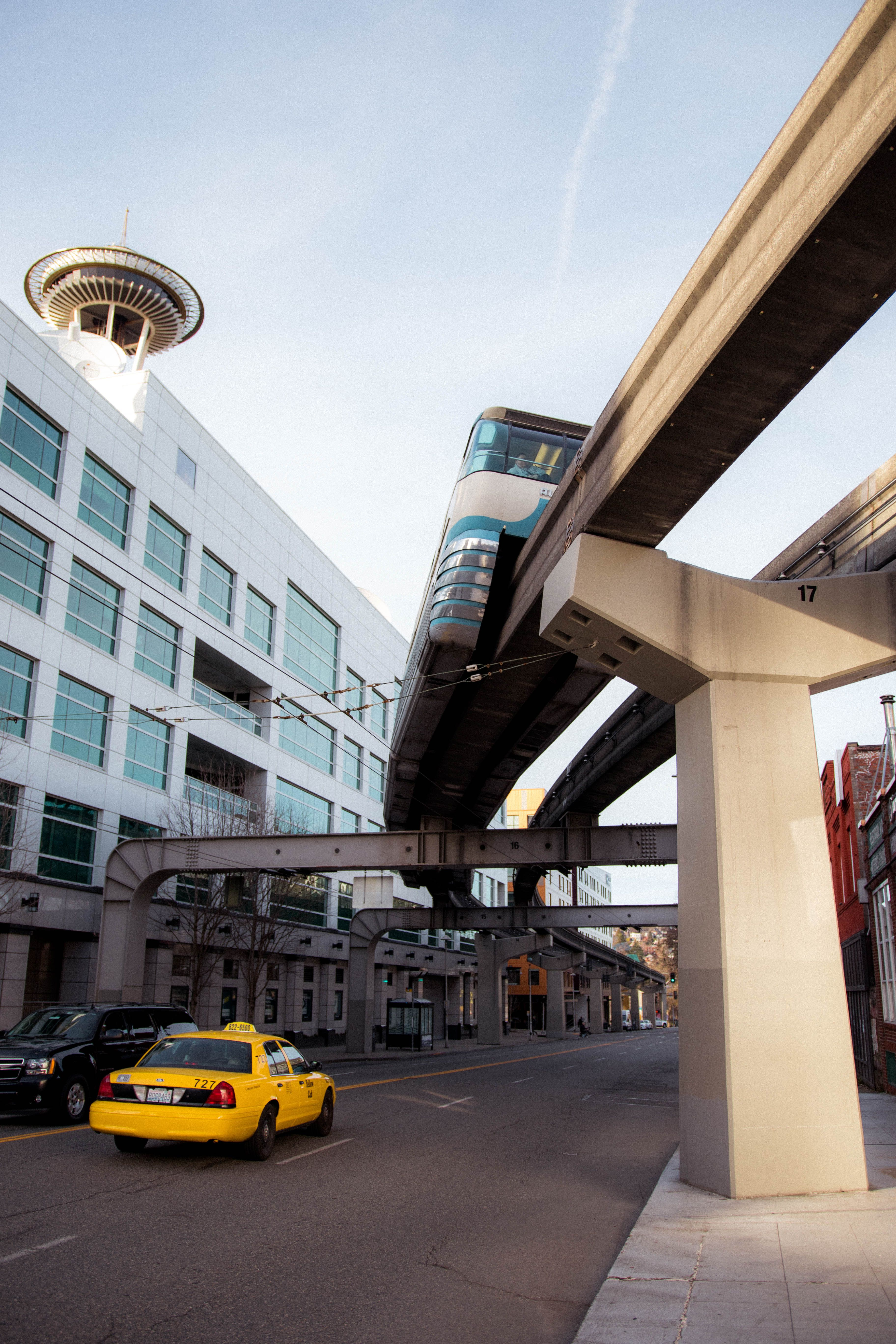 Cars driving underneath the seattle elevated train