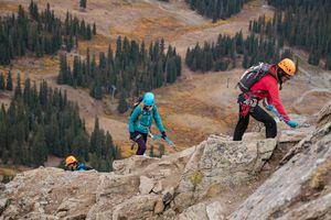 Climbers ascending Arapahoe Basin via ferrata