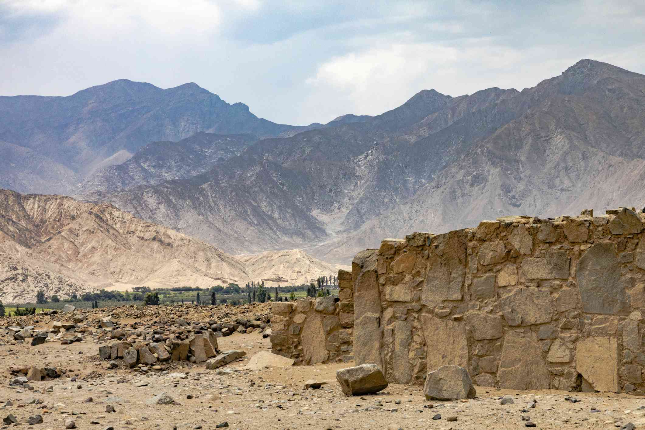 Scenic View Of Mountains Against Sky In Caral