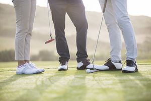 low shot of three people on golf course