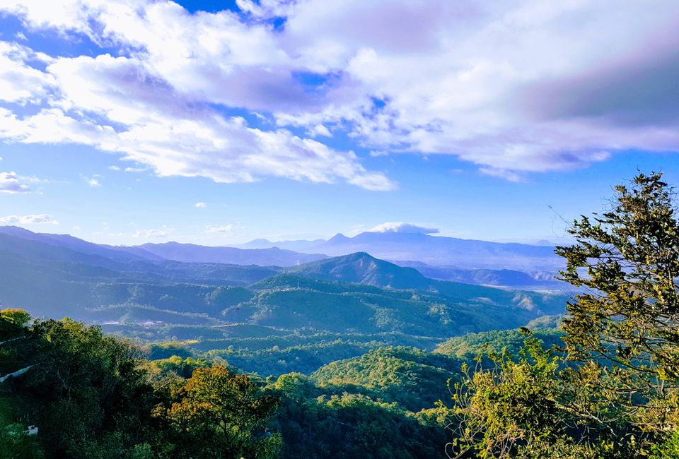 Scenic View Of Forest And Mountains Against Sky