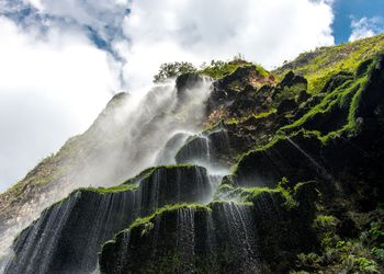 extreme low angle view of a waterfall tricking over the side of a cliff in Sumidero Canyon