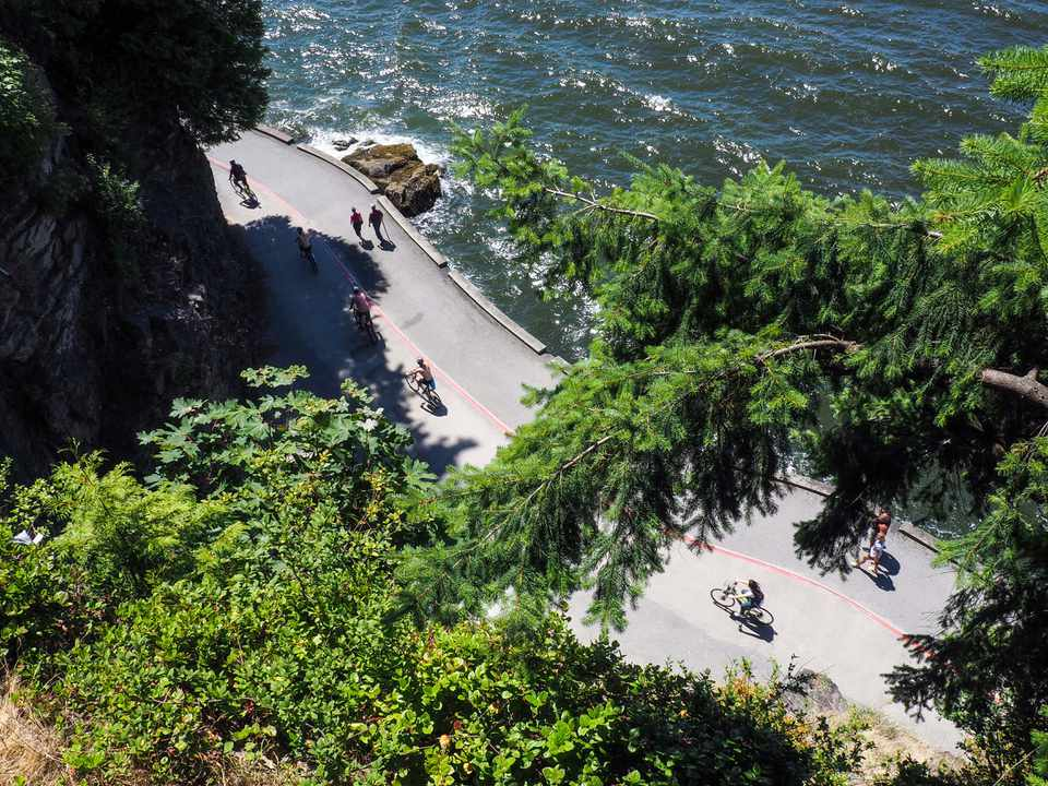 People biking on the stanley park seawall