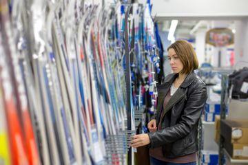 woman buys skis