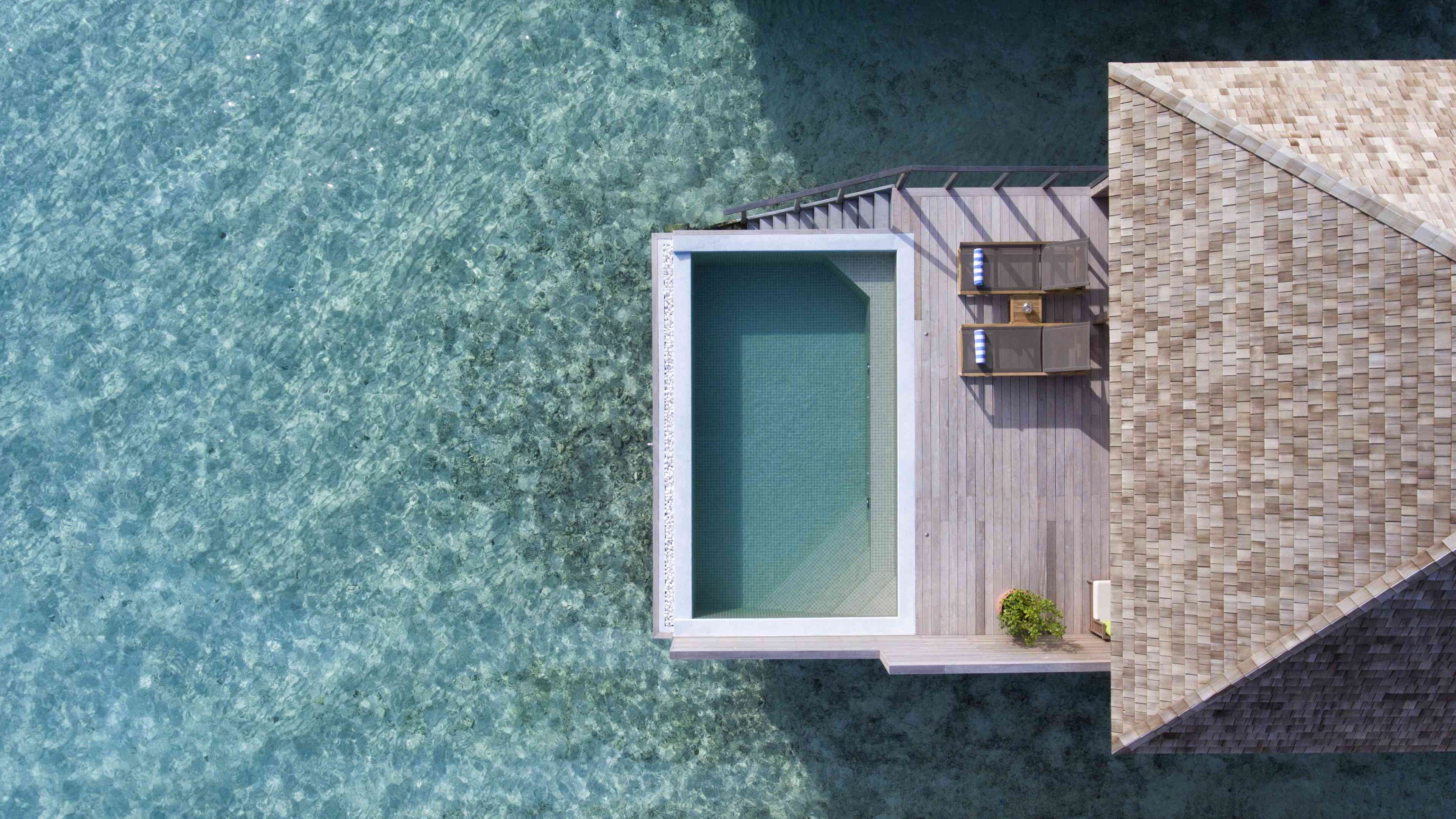 overhead shot of an Overwater pool villa at Hurawalhi Island Resort
