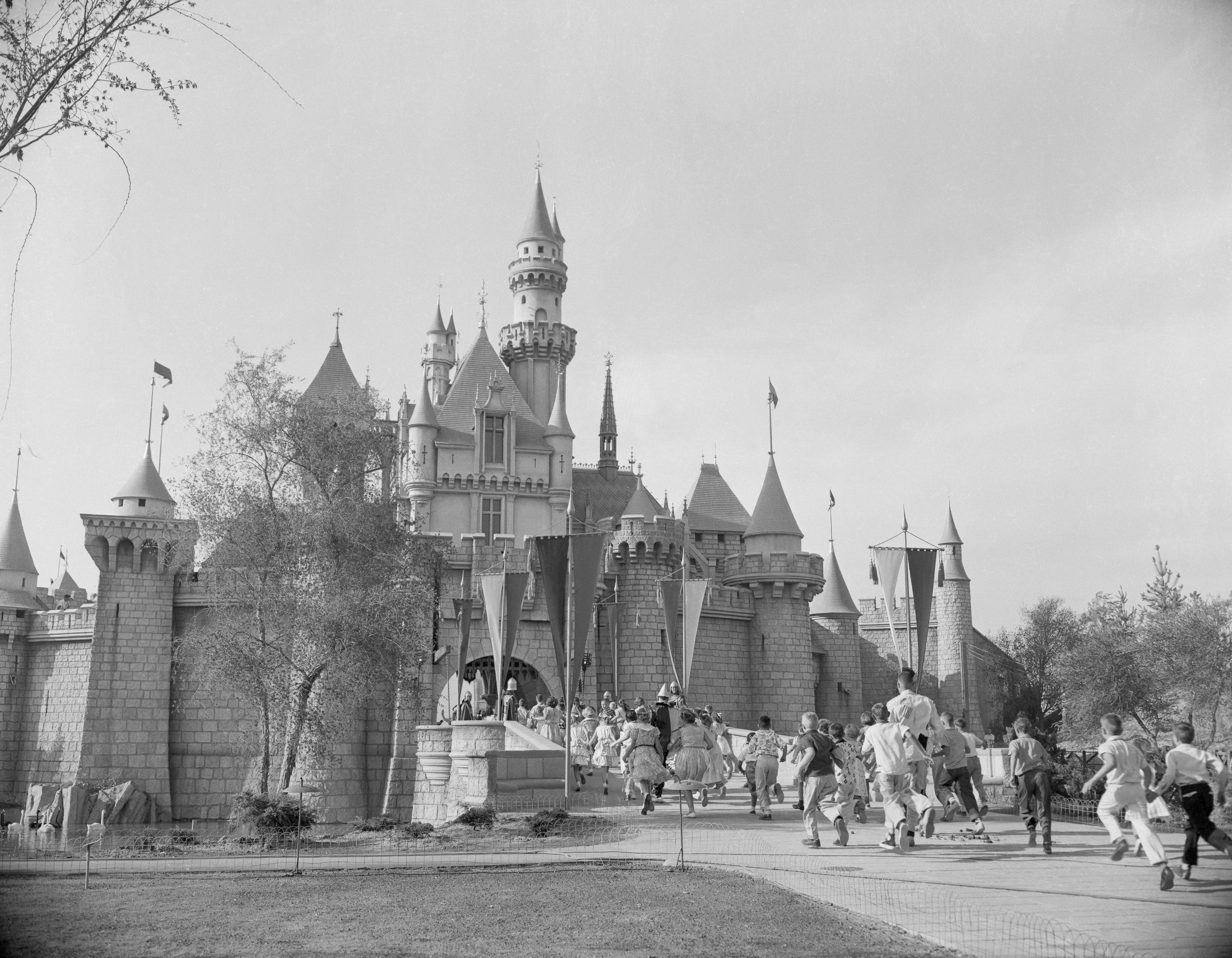Rushing Toward Sleeping Beauty Castle on Disneyland's Opening Day