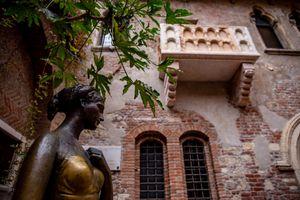 Juliet's balcony and statue in Verona, Italy