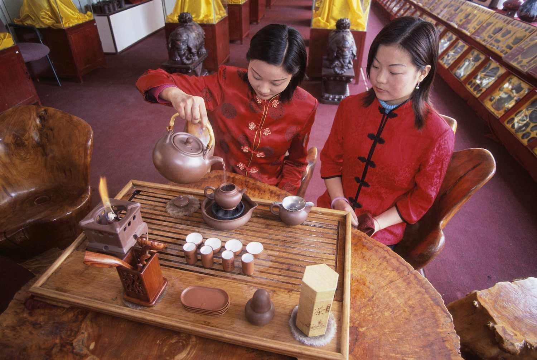 Women Performing Traditional Tea Ritual