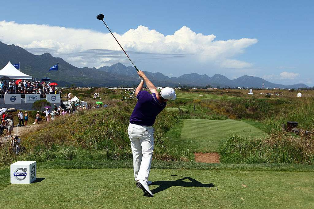 Golfer taking a shot at The Links at Fancourt, George