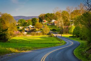 Windy country road and view of farms and houses in the Shenandoah Valley of Virginia