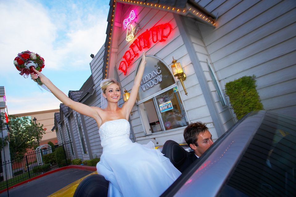 Wedding bride celebrating in convertible