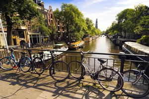 Bicycles by a canal in Amsterdam