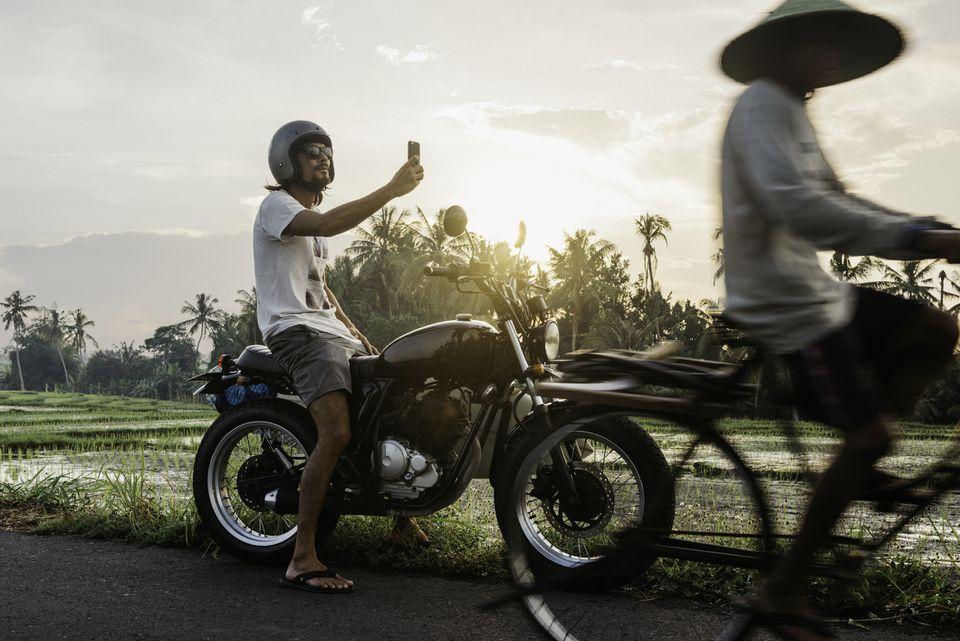 Tourist selfie-ing next to rice paddies in Indonesia