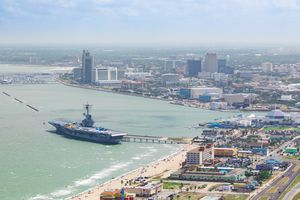Aerial View of tourist destinations around the Corpus Christi area including downtown, USS Lexington Museum on the Bay, Texas State Aquarium, Art Museum of South Texas, American Bank Center, North Beach