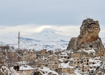 Ortahisar Town and Erciyes Mountain at winter, Cappadocia, Turkey - stock photo