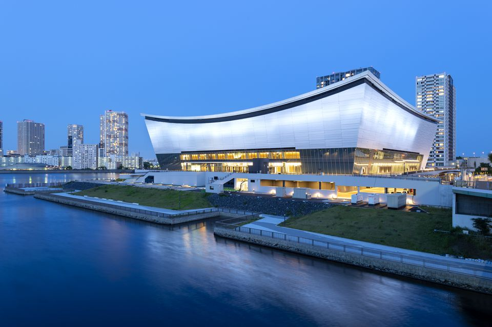 View of Ariake Arena lit up after sunset