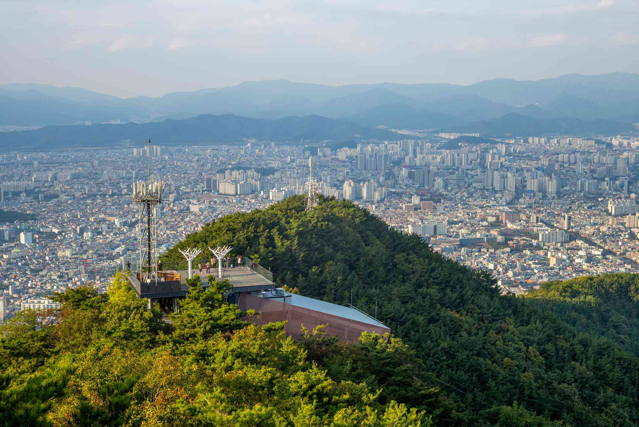mountain top observation deck on aspan park with a large city below