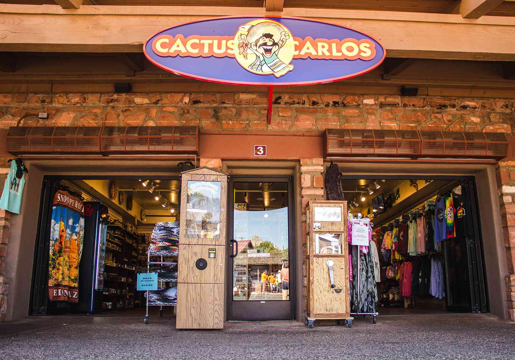 Low angle view of the entry to Cactus Carlos, a souvenir shop. There is a sign above the door that says