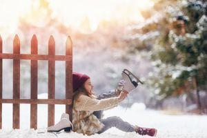 Girl putting on ice skates
