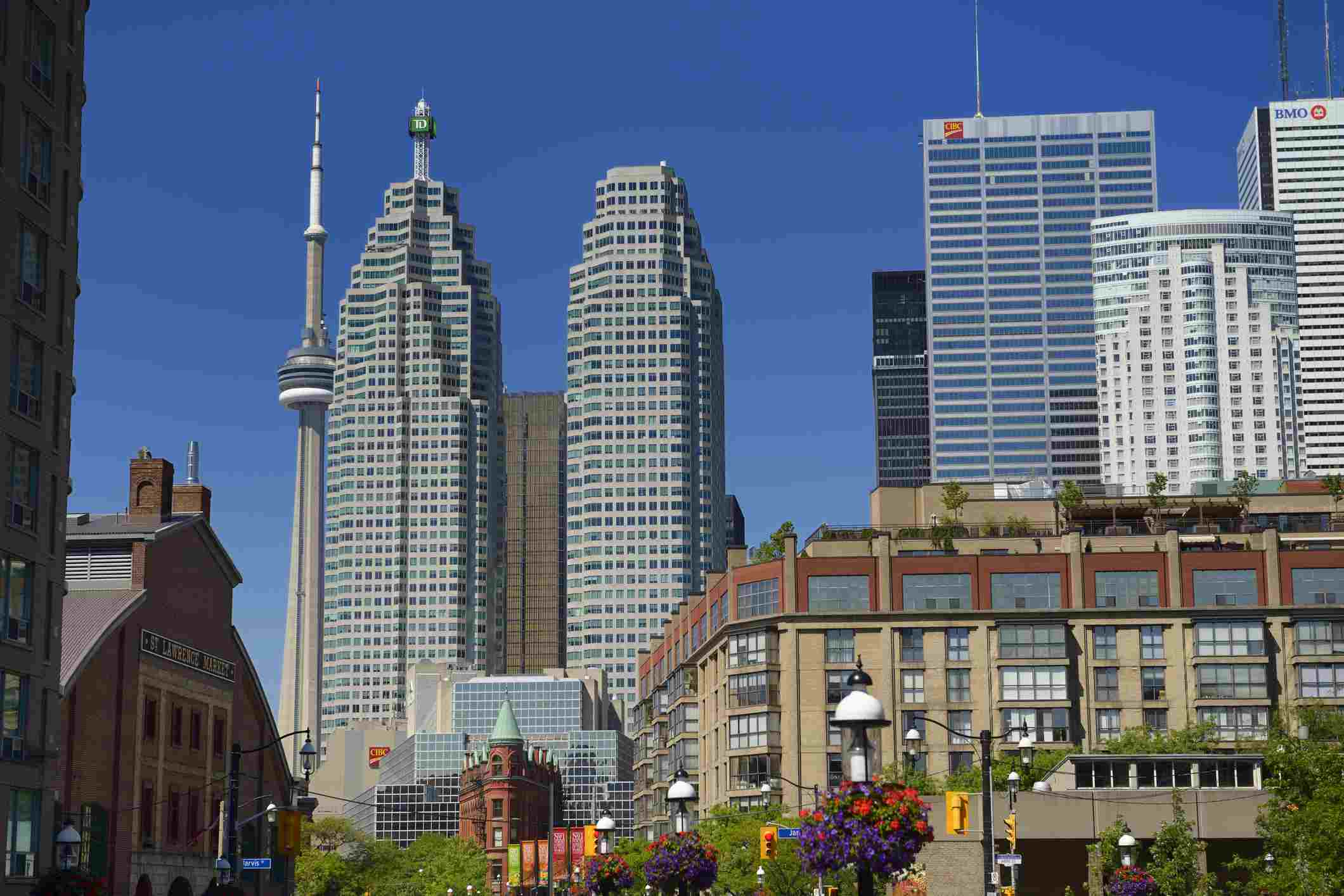 St Lawrence Market and Gooderham Flatiron building with financial district bank towers