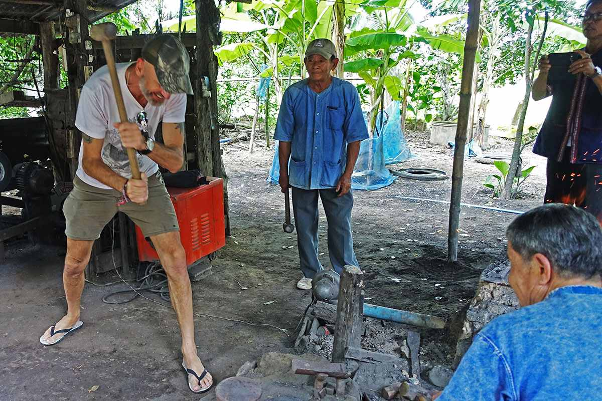 Blacksmithing at a Tai traditional village