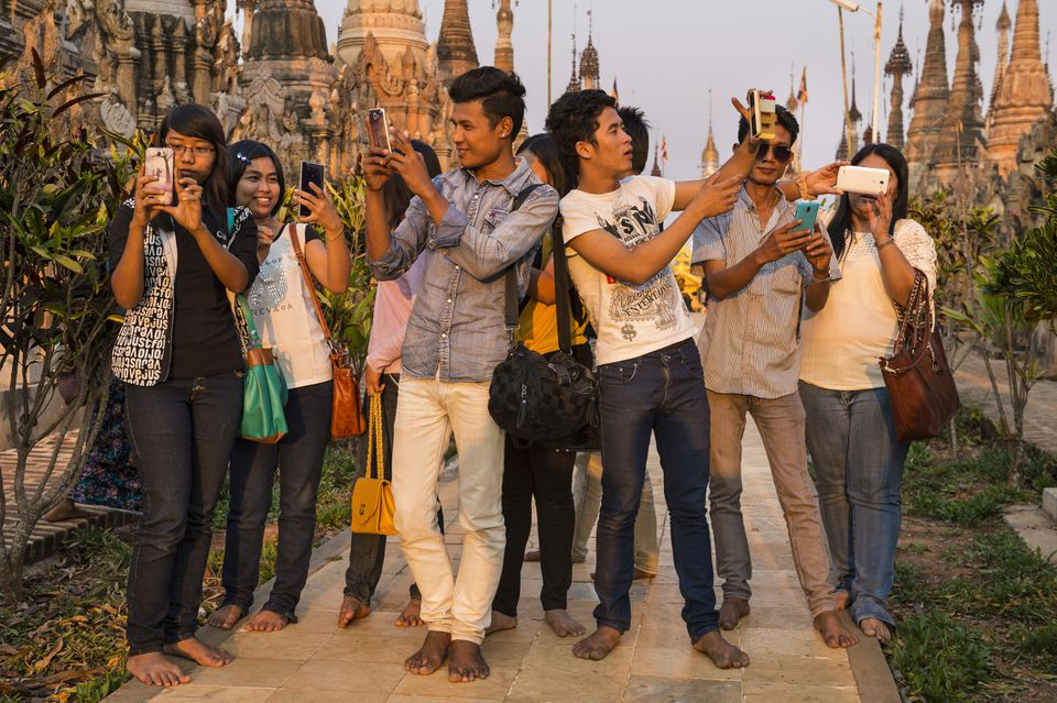 Burmese visitors selfie-ing at Kakku pagoda in Myanmar