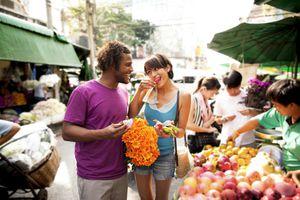 Couple shopping in outdoor market, Bangkok, Thailand