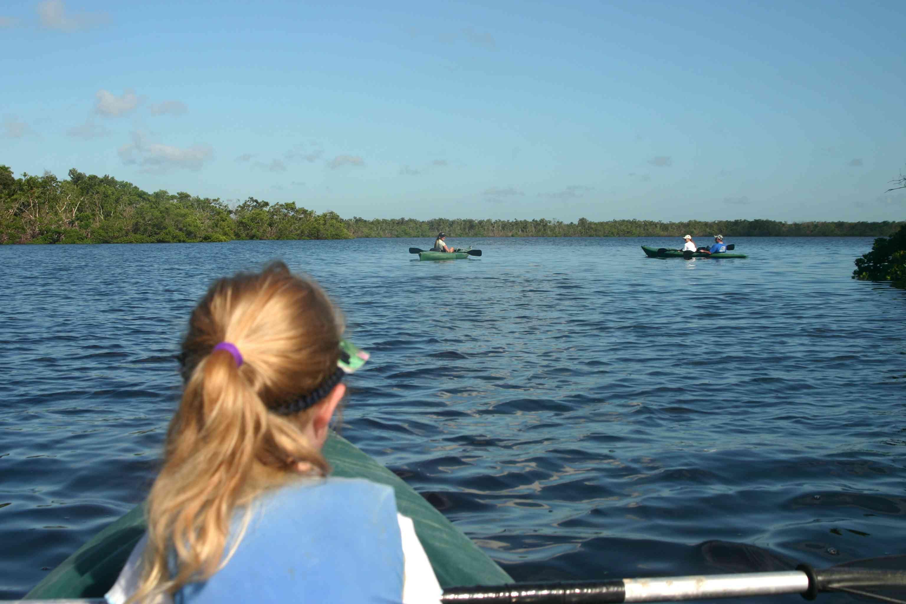 Someone kayaking and looking at other people kayaking off Sanibel Island