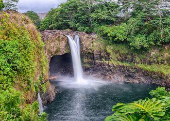 Scenic View of Waterfall In Hilo, Hawaii