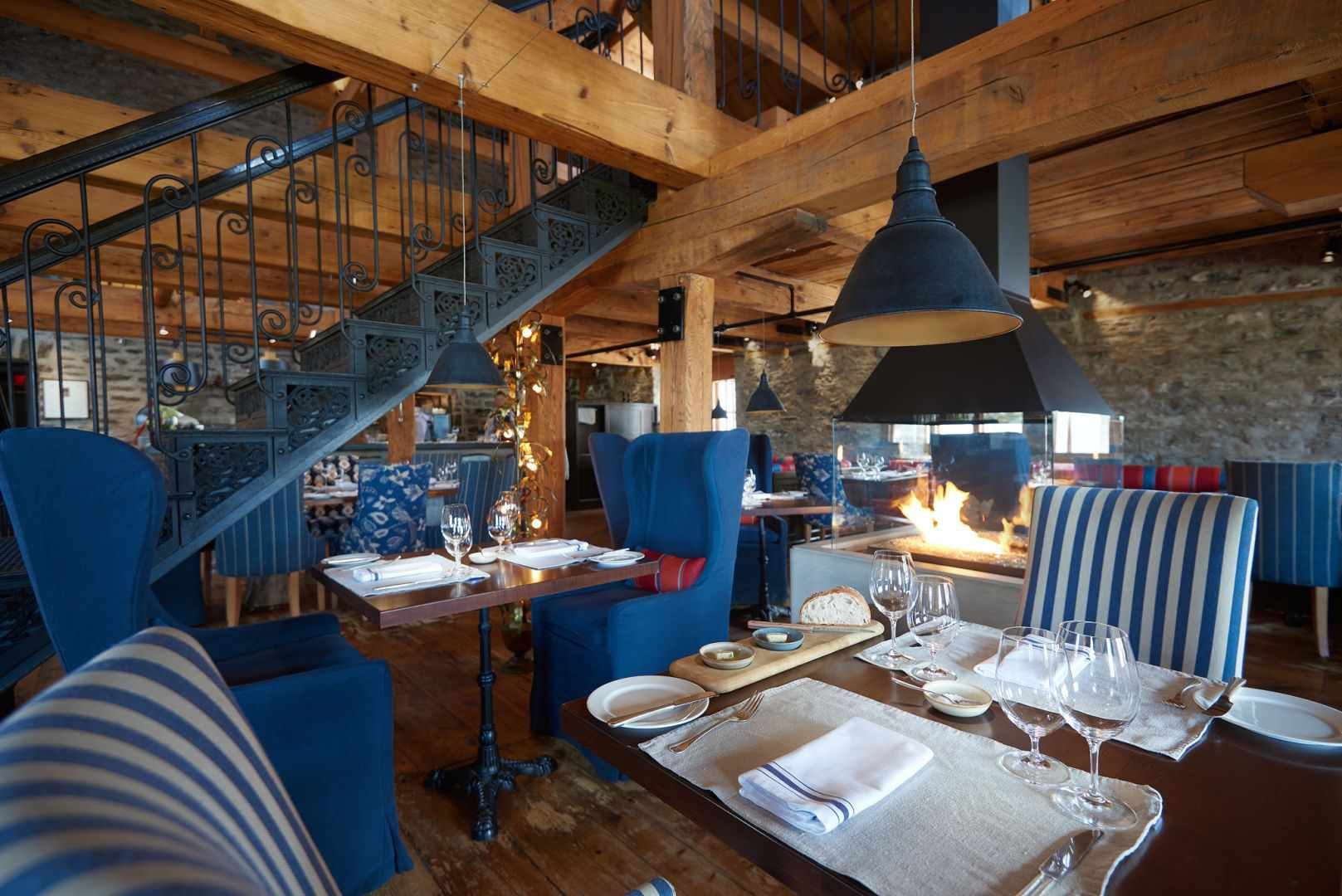 blue and white chairs in a wood-accented dining room at Chez Muffy