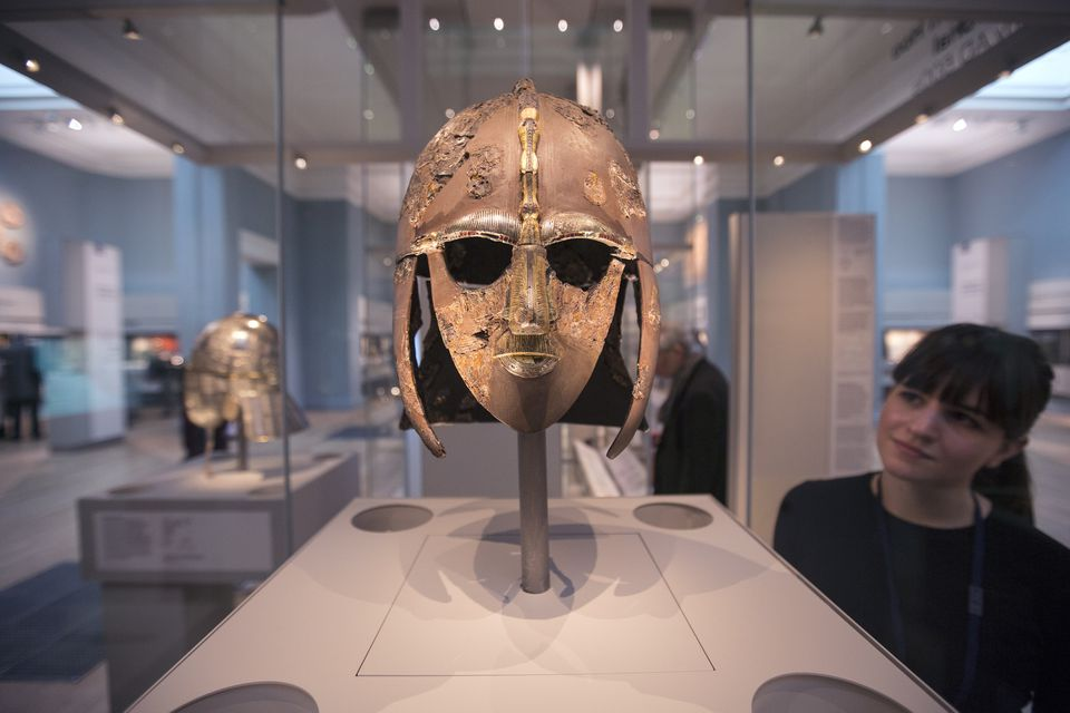 utton Hoo Treasure Displayed At The British Museum LONDON, ENGLAND - MARCH 25: A woman views the Sutton Hoo Helmet on display in the new gallery 'Sutton Hoo and Europe AD 300-1100' in the British Museum on March 25, 2014 in London, England. The exhibition in the museum's early medieval collections marks 75 years since the discovery of the Sutton Hoo treasure. The gallery's centrepiece are the archelogical finds from the Sutton Hoo ship burial in Suffolk; one of Britain's most spectacular and important discoveries. The exhibition opens to the general public on March 27, 2014.
