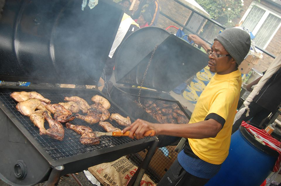 Street vendor preparing jerk chicken