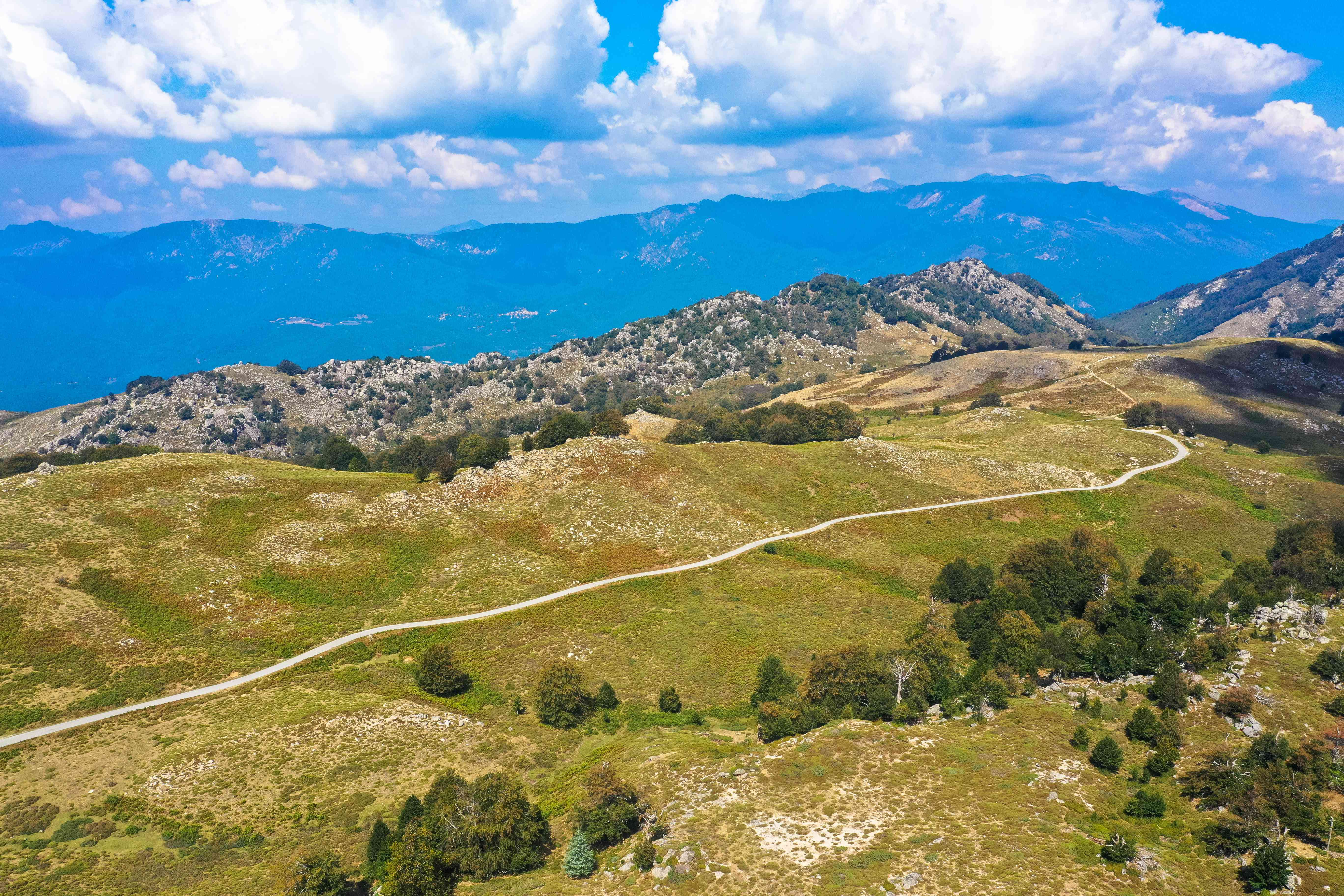 Panoramic view of the natural landscape and hiking area of the GR20 route from the Plateau of Coscione, Corsica, France