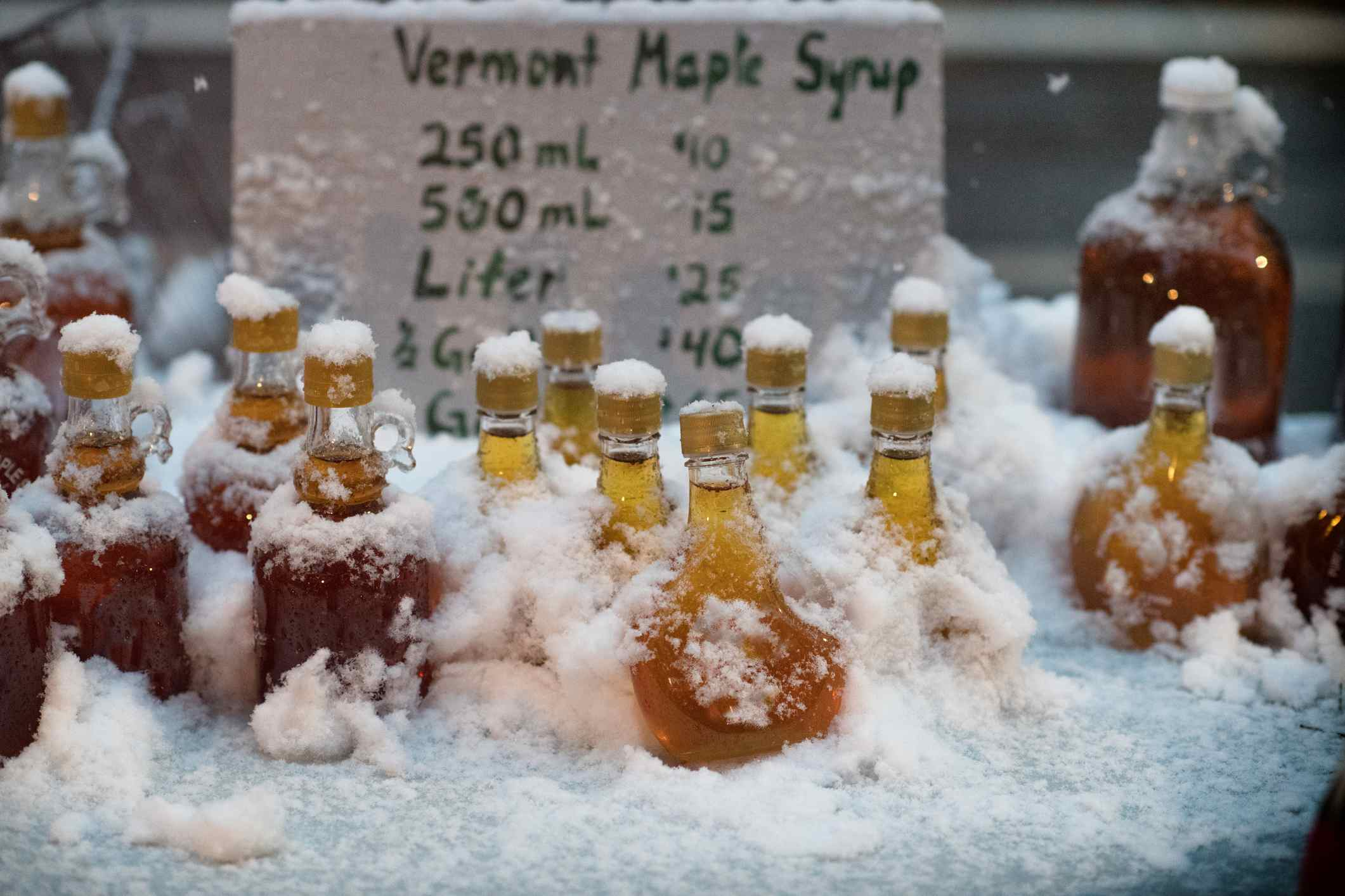 An out door stand selling Vermont Maple syrup in winter